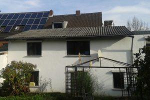 Haus in Hürth, das alte Dach - Gartenansicht